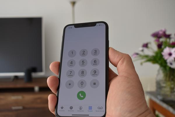 Tela do Iphone mostrando números para discar